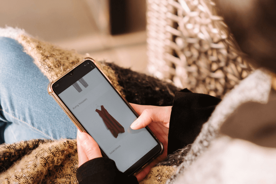 What Percentage of Online Shopping Is Mobile - Woman using smartphone for shopping