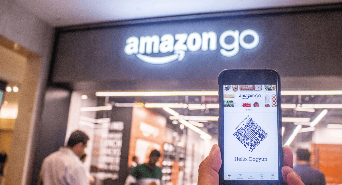 Amazon Statistics - A phone in front of Amazon Go