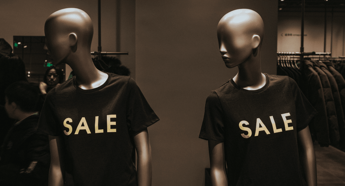 Coupon Statistics - Mannequins with T-shirts that say sale