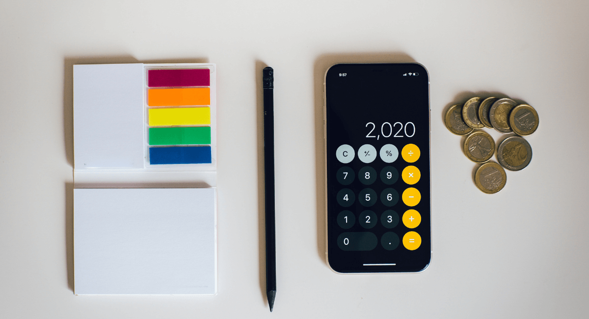 Coupon Statistics - Notepad, pencil, calculator, coins