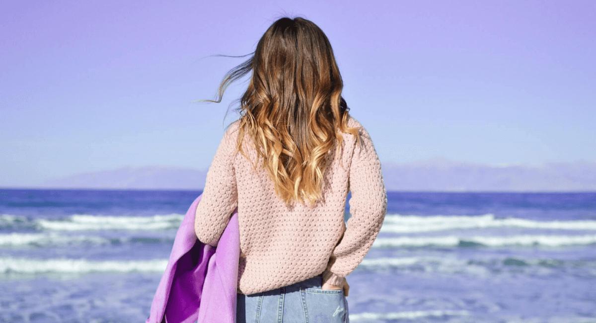 Fashion Industry Statistics - Woman looking at sea
