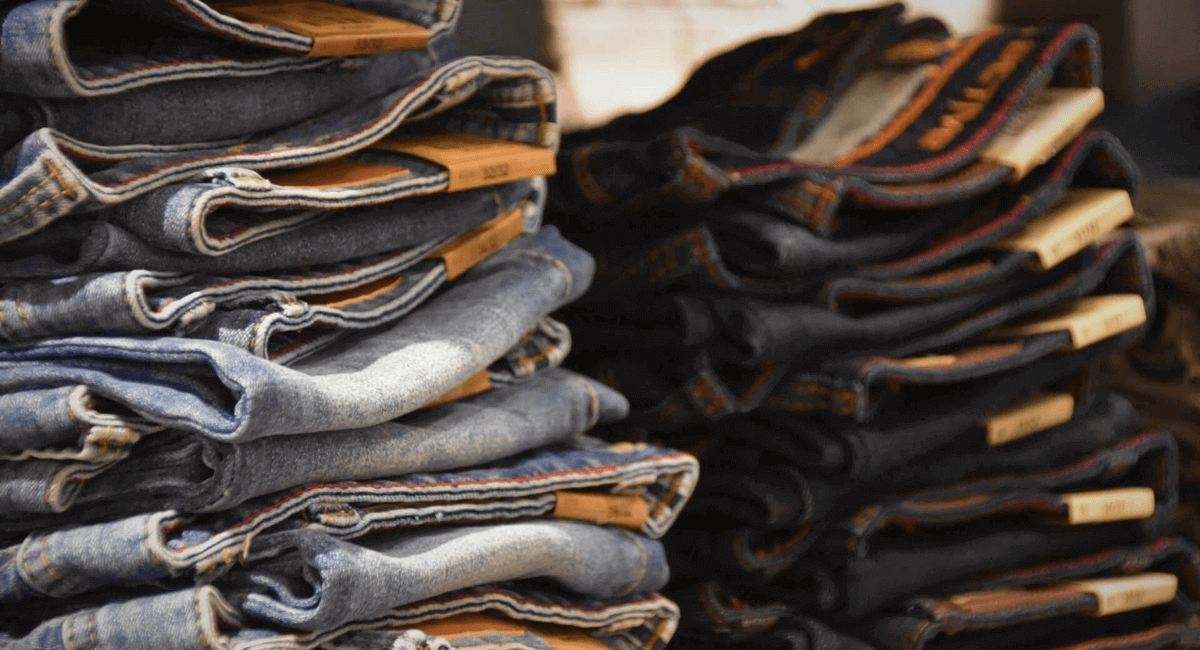 Fast Fashion Industry Statistics - A pile of jeans