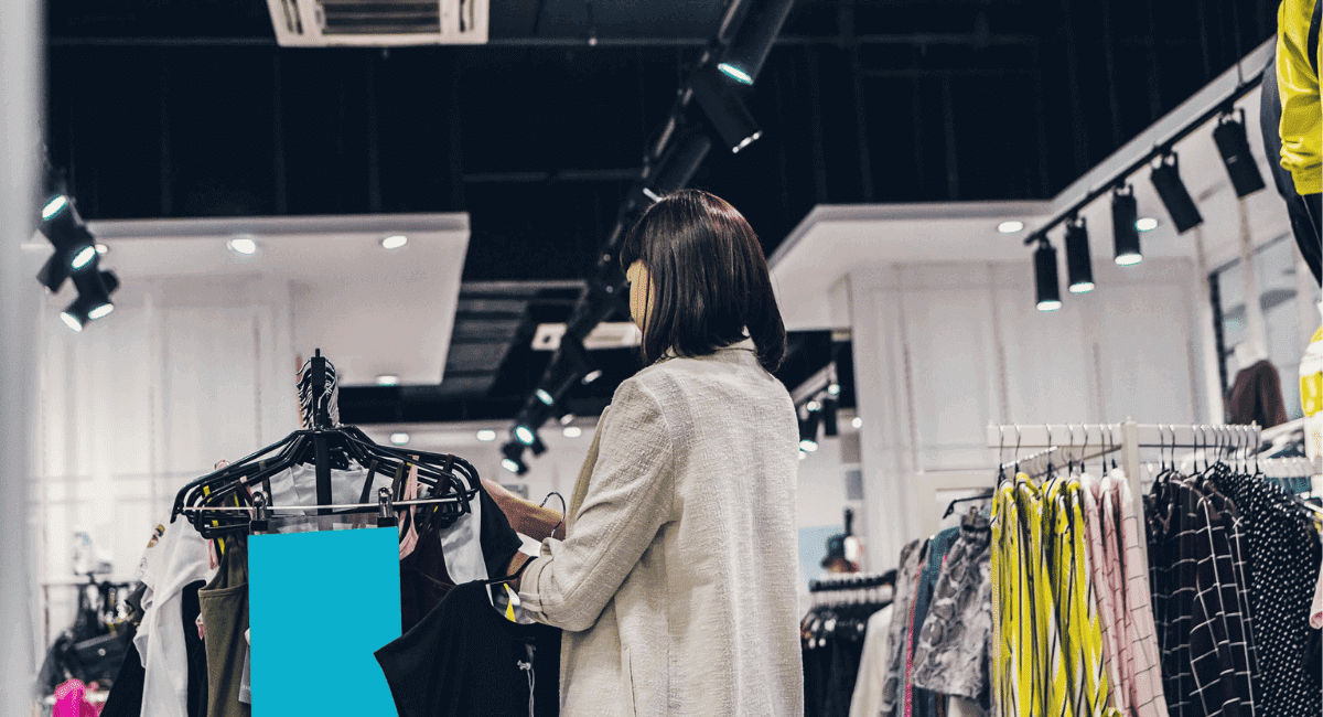 Fast Fashion Industry Statistics - Woman browsing in a store