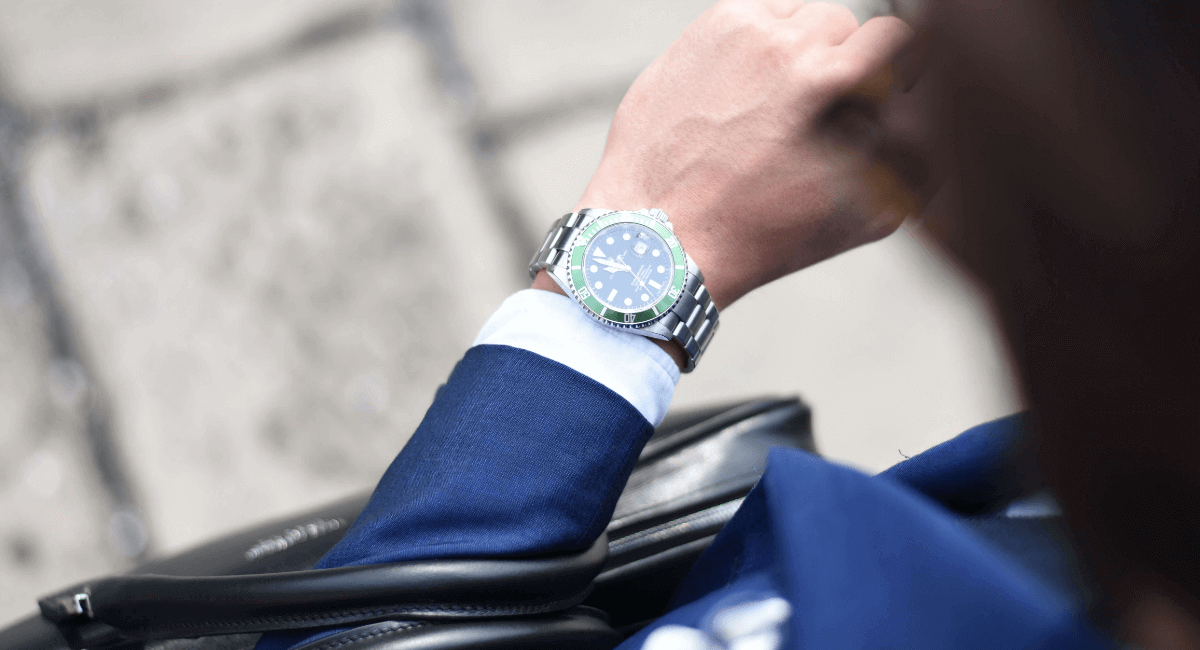 Luxury Shopping Statistics - businessman looking at his watch