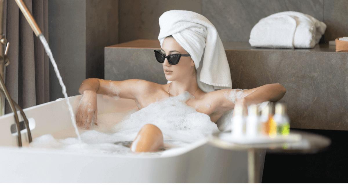 Luxury Shopping Statistics - Woman enjoying a luxury bath