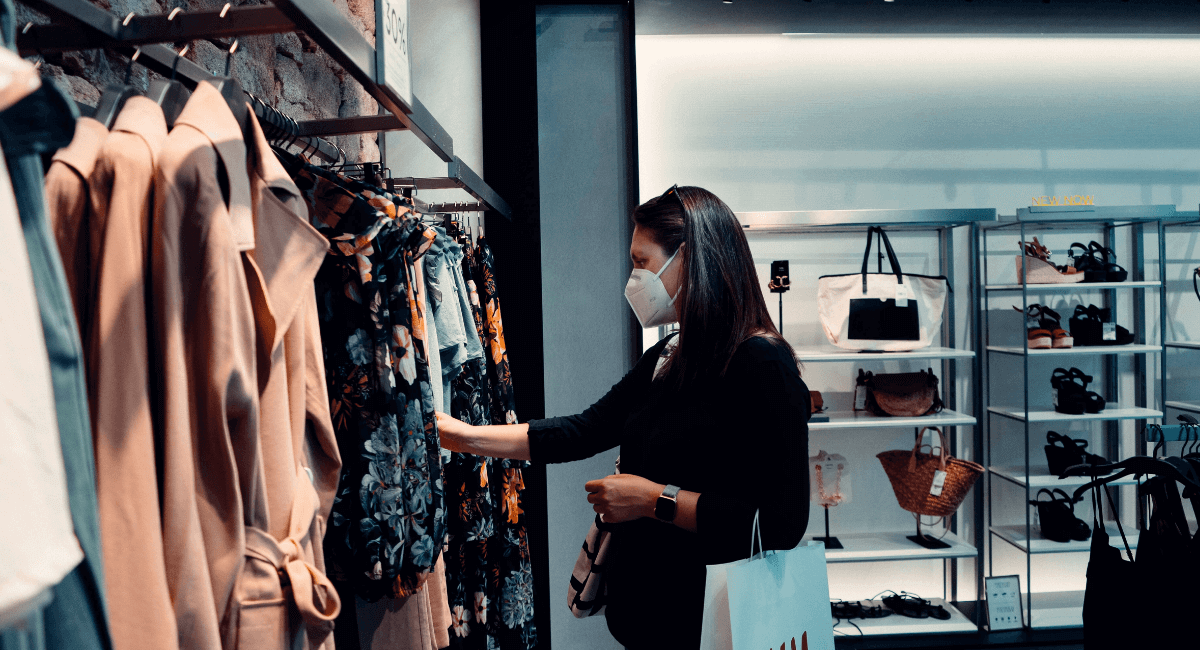 Shopping Addiction Statistics - Woman browsing in a store