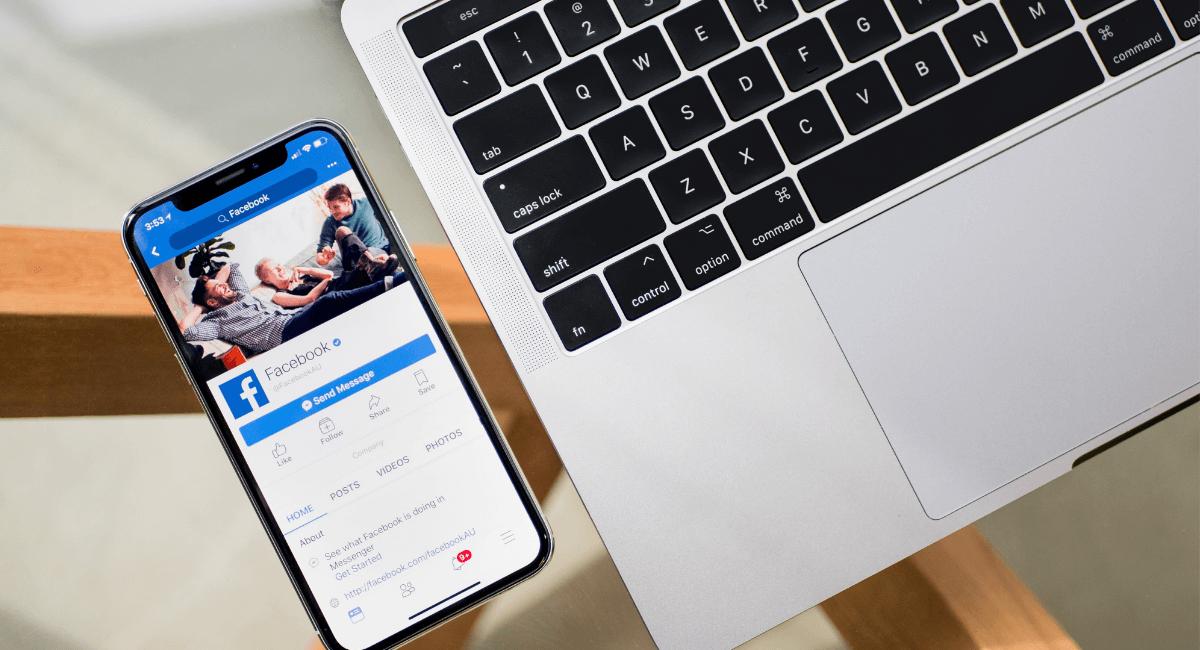 Social Commerce Statistics - Facebook on a smatphone